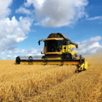 yellow harvester on the field