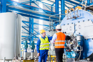 Two man checking an industrial plant
