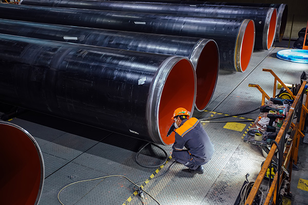 Man at maintenance work at a pipeline