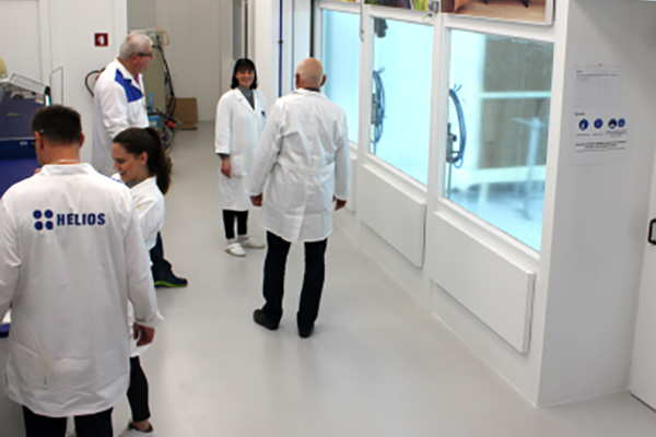 Five people in a technical training room for metal coatings
