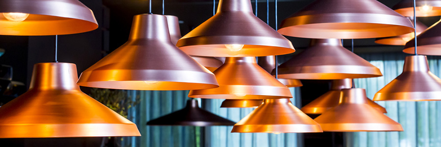 copper lights hanging from the ceiling