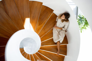 Woman sitting on a wooden stair