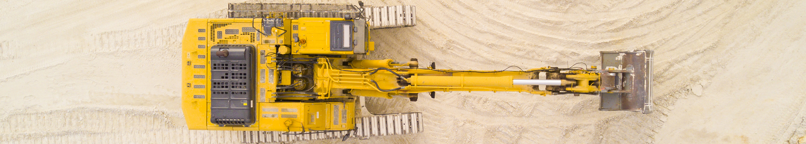 yellow excavator from air