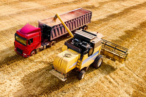 Harvester and truck